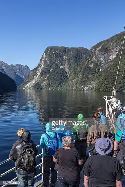 Tourists Group on a Cruise at Doubtful Sound, New Zealand