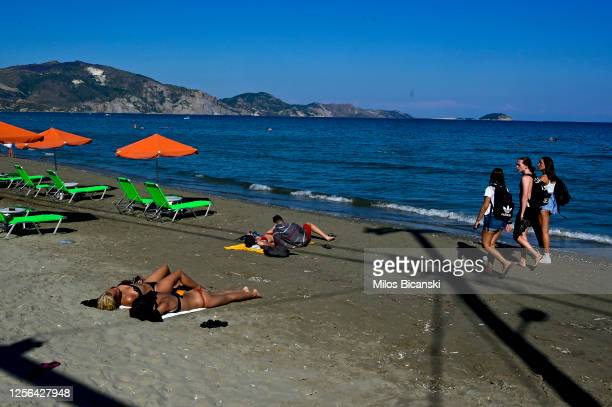 Tourists have sunbath on beach on Zakythos Island.Tourist mainly from United Kingdom and Italy are guest on Zakinthos Island on July 15, 2020 in...