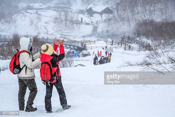 Tourists having fun in the snow in Changbai Mountains National Nature Reserve, located in Jilin province of China, during winter of 2013.