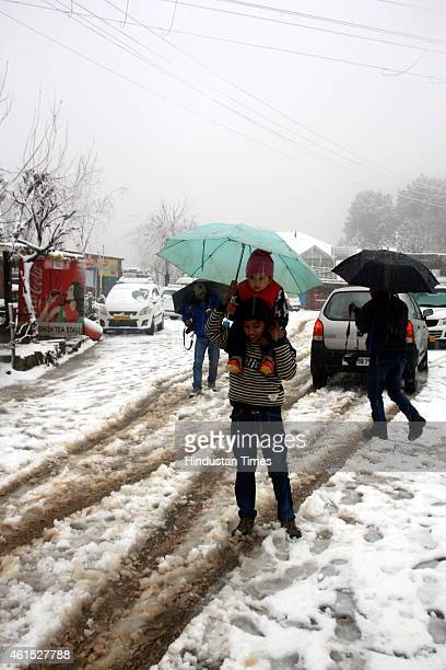 Tourists having fun with snow during snowfall at Naddi village on January 14 2015 in Dharamsala India Shimla and its surrounding resorts of Kufri...