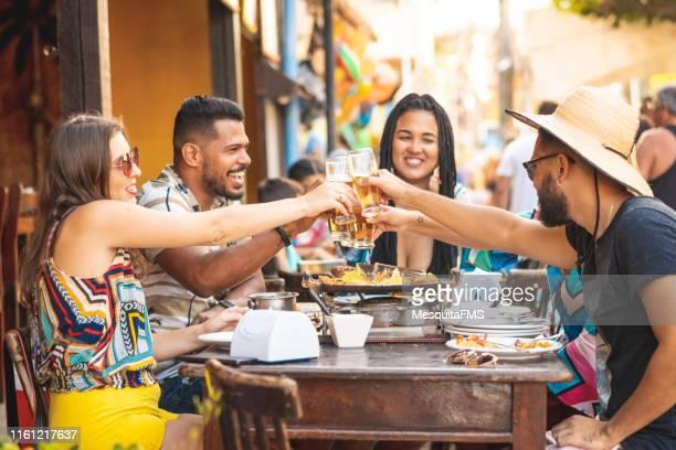 tourists having lunch at a restaurant in porto de galinhas - porto galinhas stock photos and pictures