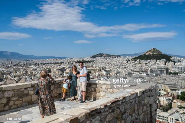 Tourists hike around the Acropolis on May 23, 2020 in Athens, Greece. After months of being on lockdown due to the coronavirus, Greece has opened its...