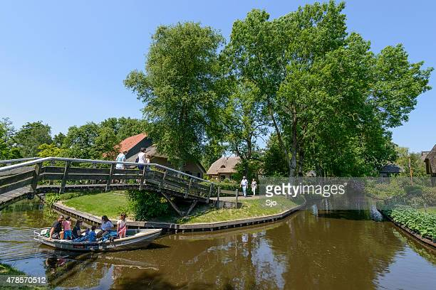 Tourists in a boat on the canal in Giethoorn
