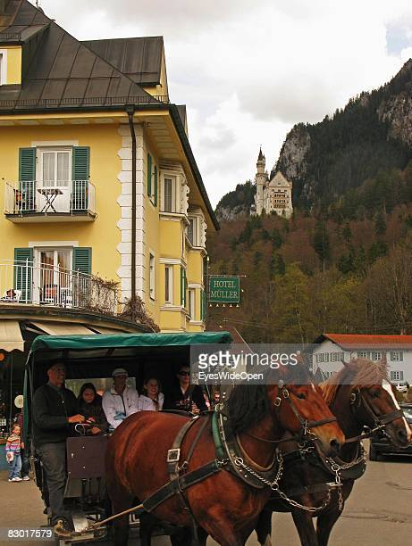 Tourists in a coach on a sightseeing tour to castle Neuschwanstein on September 24 2008 in Hohenschwangau Ostallgaeu Germany The castle was rebuilt...