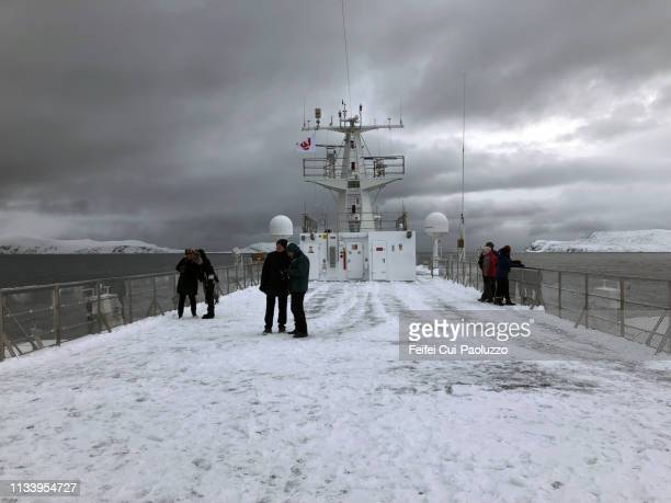 tourists in a ferry boat at arctic sea near havøysund, northern norway - feifei cui paoluzzo stock pictures, royalty-free photos & images