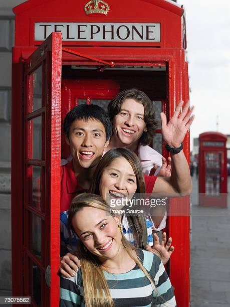 Tourists in a red telephone booth