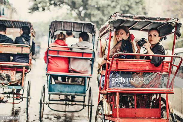 tourists in a rickshaw - delhi stock pictures, royalty-free photos & images