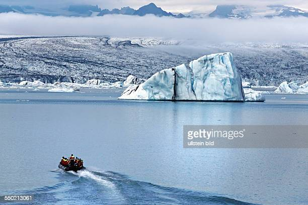 Tourists in a rubber boat at the Joekulsarlon Glacier Lagoon South Iceland