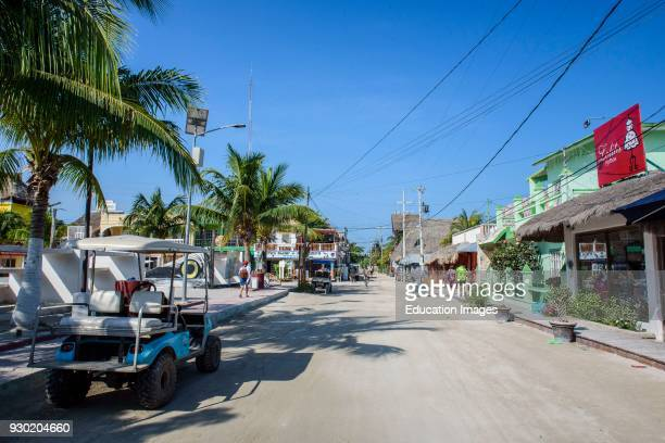 Tourists in a street of Isla Holbox Quintana Roo Mexico