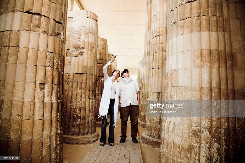 Tourists in a temple : Stock Photo