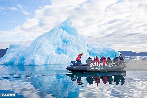 Tourists in a Zodiac in front of an iceberg, Greenland