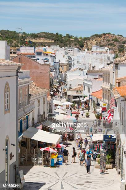 tourists in albufeira portugal - algarve stock photos and pictures