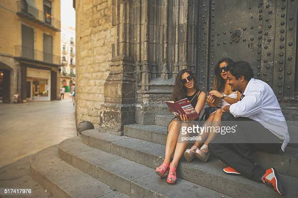 Tourists in Barri gothic, Barcelona, with guide book