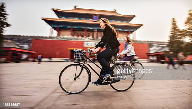 tourists in beijing riding bikes - beijing province stock photos and pictures