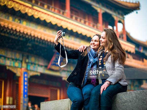 tourists in beijing visiting lama temple - beijing stock pictures, royalty-free photos & images