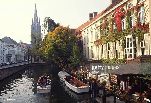 tourists in boat, bruges,belgium - bruges stock pictures, royalty-free photos & images
