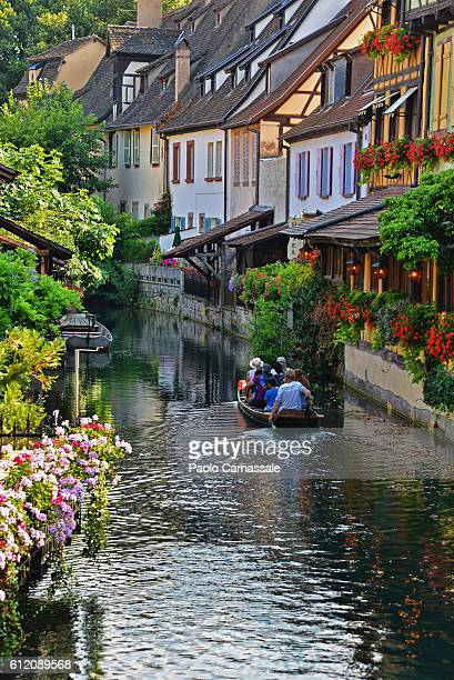 Tourists in boat on a  canal in Colmaf, France