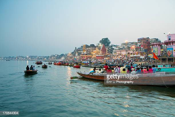 Tourists in boats on River Ganges at Varanasi in the early morning. -Northern India