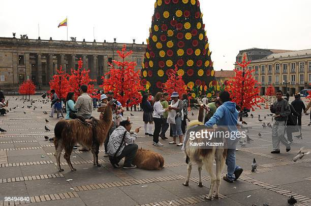 Tourists in Bolivar square prior to Christmas in the old part of the city Bogota formerly called Santa Fe de Bogota is the capital city of Colombia...