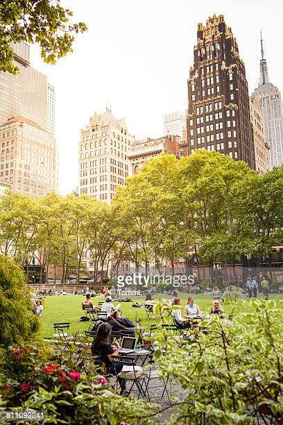 tourists in bryant park, new york city - bryant park stock pictures, royalty-free photos & images