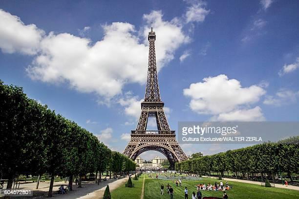 Tourists in Eiffel Tower park, Paris, France