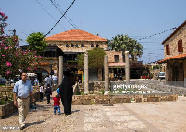 Tourists in front of antique coloumns in the historic town Mount Lebanon Governorate Byblos Lebanon on April 29 2017 in Byblos Lebanon