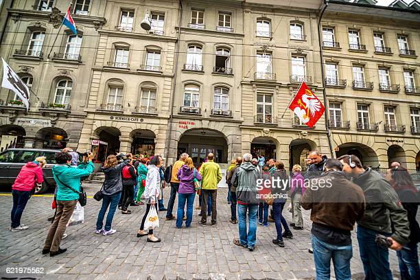 tourists in front of einsteinhaus in bern, switzerland - bern stock photos and pictures