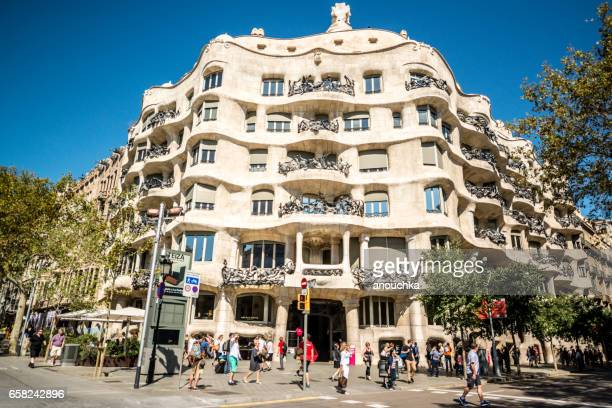 Tourists in front of famous Casa Mila, Barcelona, Spain