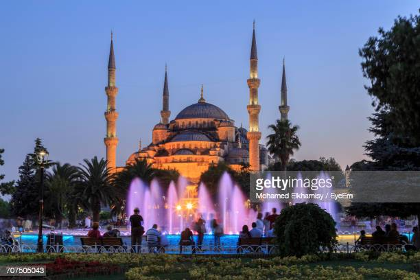 Tourists In Front Of Illuminated Sultan Ahmed Mosque At Dusk