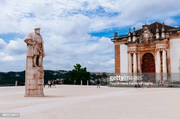 Tourists in front of 'Joanina' Library with the statue of King Joao III outside in University of Coimbra