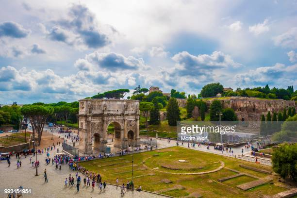 Tourists in front of the Arch of Constantine, Rome, Lazio, Italy