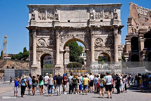 Tourists in front of the Arch of Constantine the central archaeological area which includes the Coliseum is one of the most beloved places by Italian...