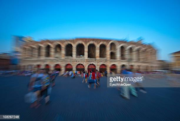 Tourists in front of the Arena of Verona on July 14 2010 in Verona Italy The famous Arena di Verona is popular for the annual opera festival in...