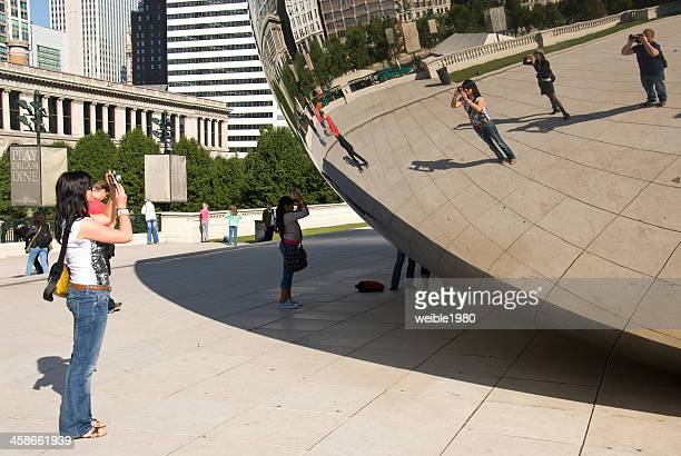 Tourists in front of the cloud gate chicago