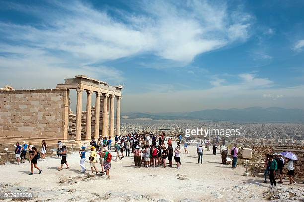 Tourists in front of the Erechtheion an ancient Greek temple dedicated to the gods Athena and Poseidon on the north side of the Acropolis of Athens