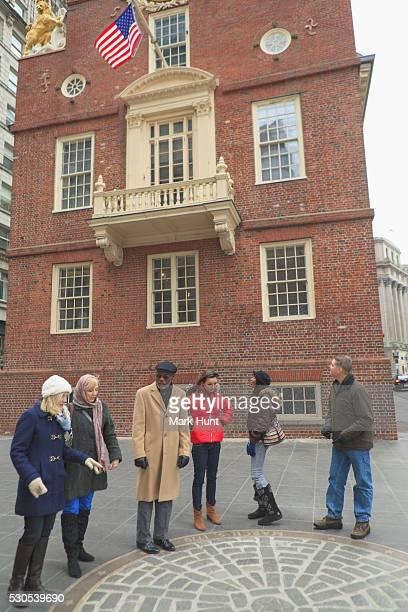 Tourists in front of The Old State House and looking at The Boston Massacre Historic Site, Boston, Suffolk County, Massachusetts, USA