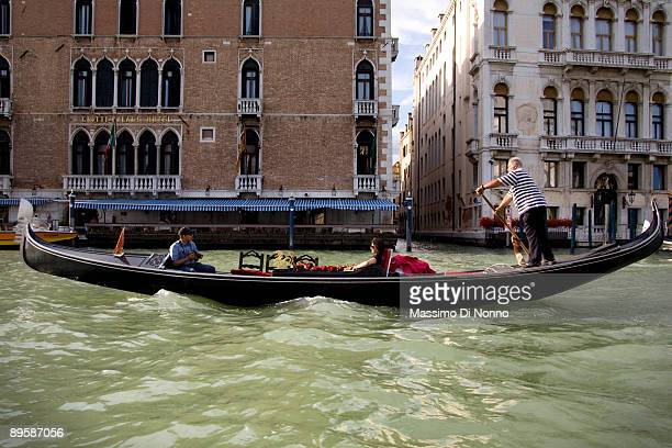 Tourists in Gondola on the Canal Grande Venice on June 11 2009 in Venice Italy