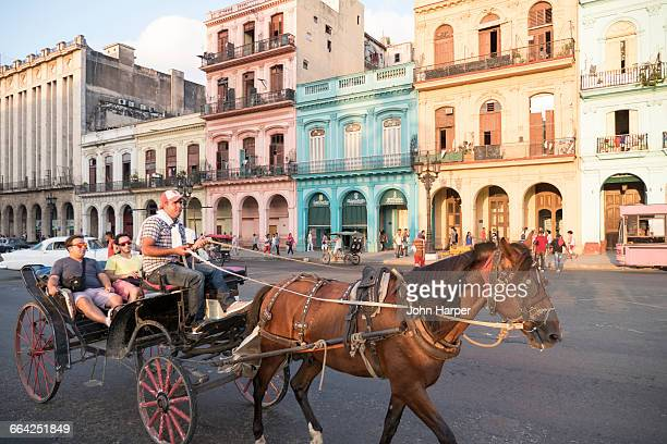 Tourists in horse carriage, Havana, Cuba