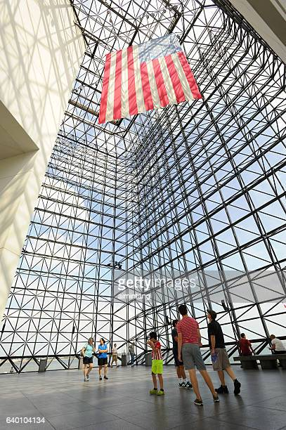 tourists in jfk library - john f. kennedy library stock photos and pictures