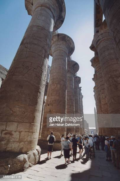 tourists in karnark temple, luxor, egypt - reality kings stock pictures, royalty-free photos & images