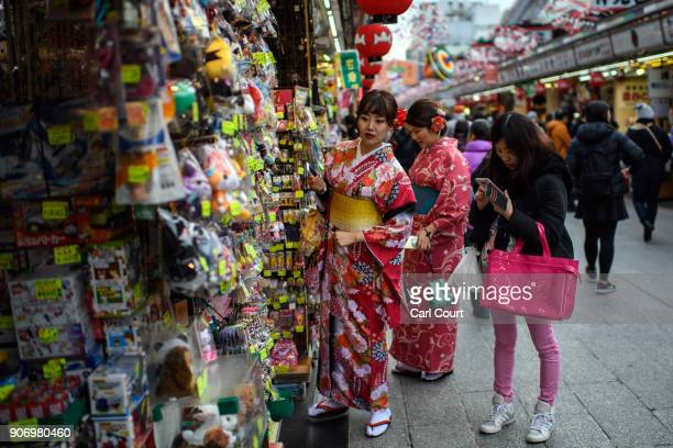 Tourists in kimonos browse a shop on Nakamisedori a shopping street near Sensoji buddhist temple on January 19 2018 in Tokyo Japan Sensoji is Tokyo's...