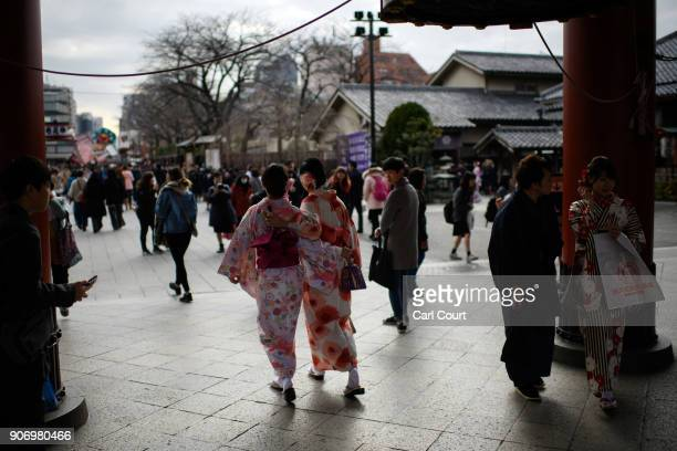 Tourists in kimonos stroll around the grounds of Sensoji buddhist temple on January 19 2018 in Tokyo Japan Sensoji is Tokyo's oldest temple dating...