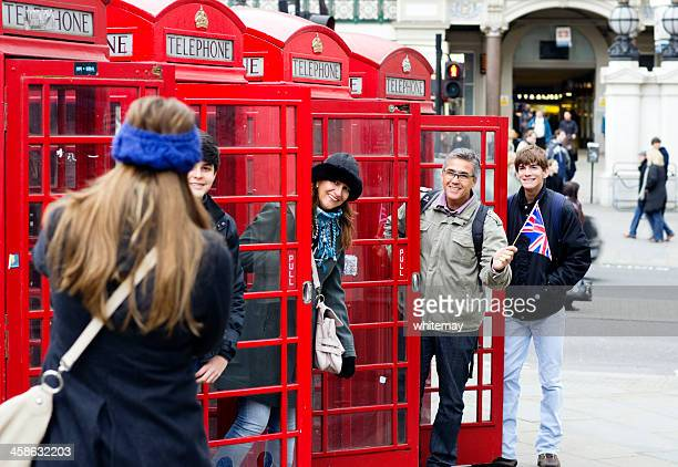 Tourists in London telephone boxes
