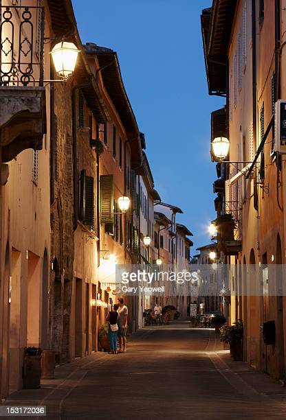 tourists in narrow street at dusk - yeowell stock pictures, royalty-free photos & images