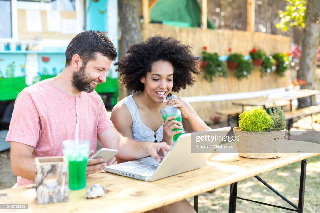 Tourists in nature surfing the net : Stock Photo