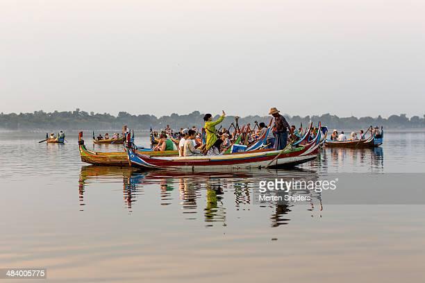 tourists in sunset canoes - merten snijders stock-fotos und bilder