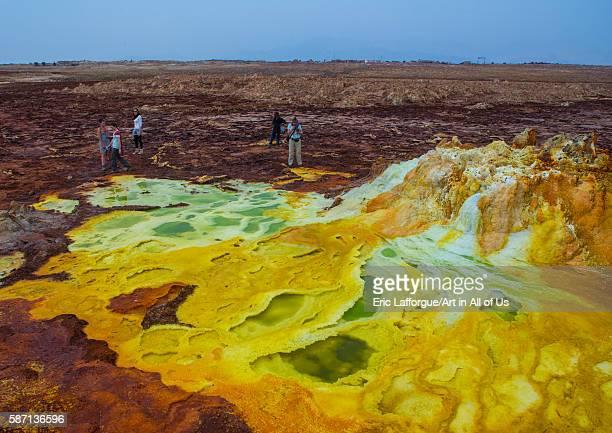 Tourists in the colorful volcanic landscape of dallol in the danakil depression, afar region, dallol, Ethiopia on February 26, 2016 in Dallol,...