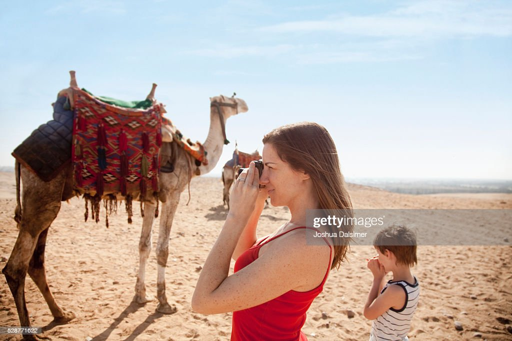 Tourists in the desert : Stock Photo