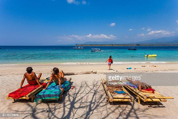 tourists in the gili islands in lombok, indonesia - gili trawangan stock photos and pictures