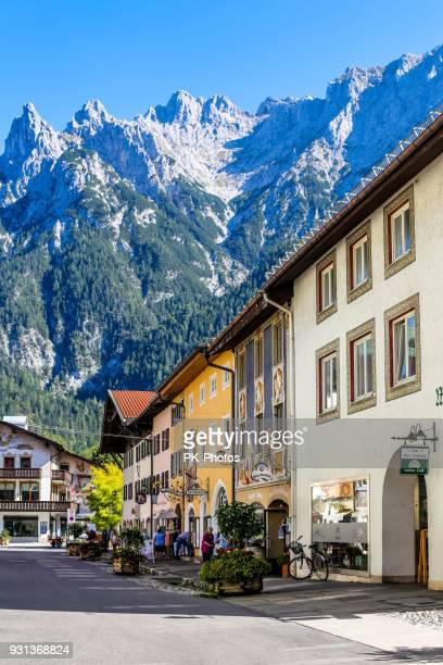 tourists in the pedestrian area of mittenwald, upper bavaria, germany - mittenwald stock pictures, royalty-free photos & images